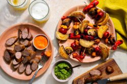 Sun Basket - Italian sausages and vegetable skewers with two romescos